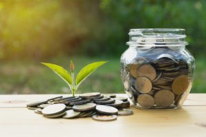 coins-jar-with-money-stack-step-growing-money_43284-774